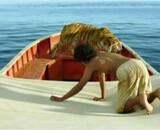 Nouvel extrait de L'Odyssée de Pi : un jeune garçon et un tigre sont dans un bateau...